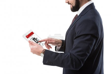 Businessman with tablet with bbc news