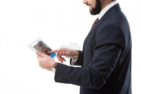 Businessman with tablet with couchsurfing website