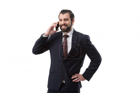 Photo for Businessman in suit talking on smartphone, isolated on white - Royalty Free Image