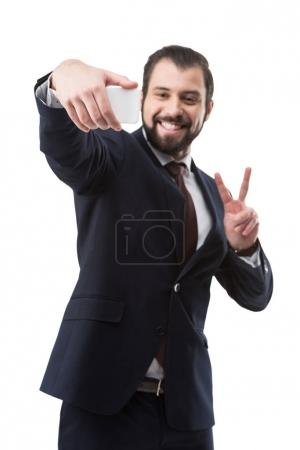 businessman taking selfie on smartphone