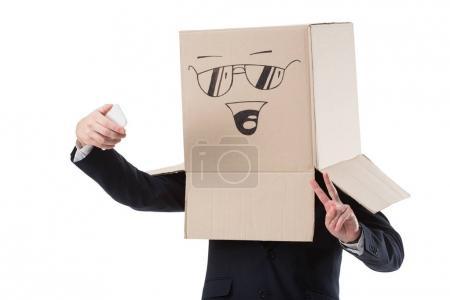 businessman taking selfie on smartphone