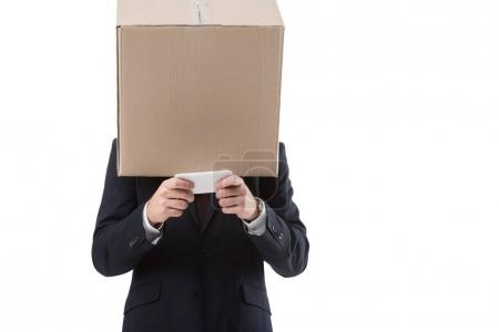 businessman with box on head using smartphone
