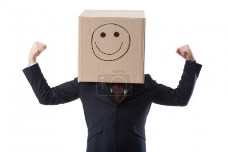 successful businessman with box with smile sign