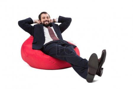 businessman relaxing on bean bag chair