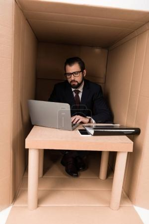 businessman with paperwork and laptop