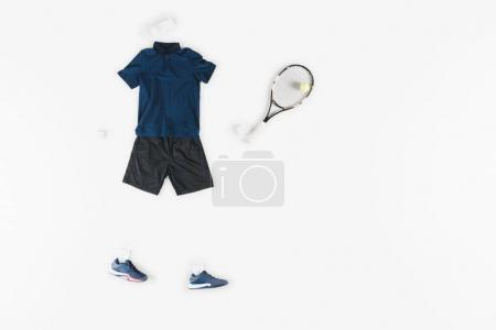 Photo for Sportive clothes with sneakers and tennis racquet with ball isolated on white - Royalty Free Image