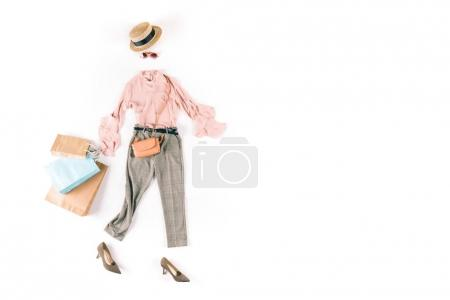 Photo for Stylish female clothes with shopping bags isolated on white - Royalty Free Image