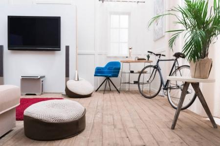 Interior of living room with TV and bicycle
