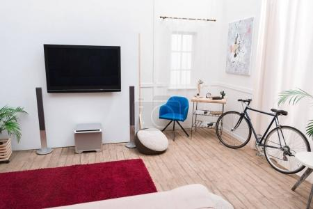 Interior of the living room with TV screen and sound speakers