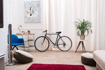 Photo for Bicycle standing in a living room near the window - Royalty Free Image