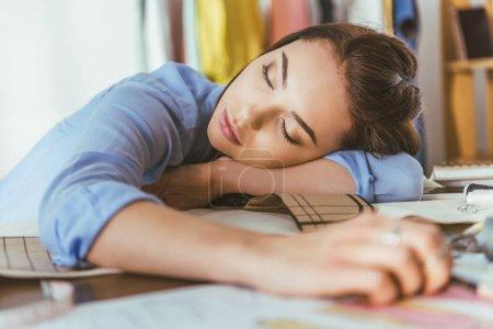 beautiful seamstress sleeping at working table