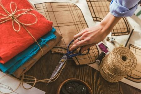 cropped image of seamstress taking scissors