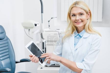 Photo for Professional oculist using digital tablet in clinic - Royalty Free Image