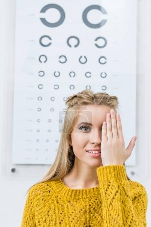 young female patient with eye test in clinic
