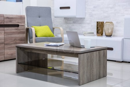 Photo for Modern living room interior with laptop on table - Royalty Free Image