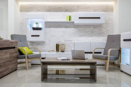 modern living room interior with laptop on table