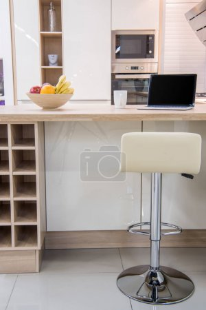 Photo for Cozy modern dinning room interior with laptop - Royalty Free Image