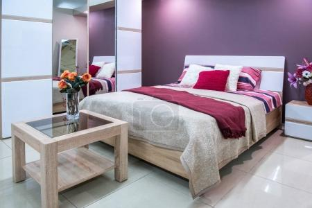 cozy modern bedroom interior in purple tones