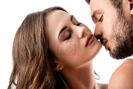 beautiful sensual couple kissing isolated on white