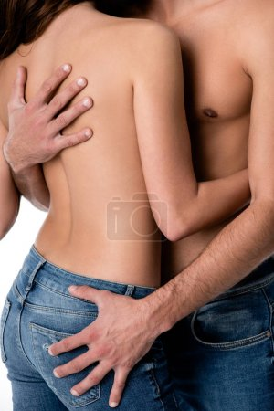 cropped image of sensual half naked couple in jeans isolated on white