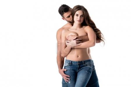 young sensual couple in jeans isolated on white