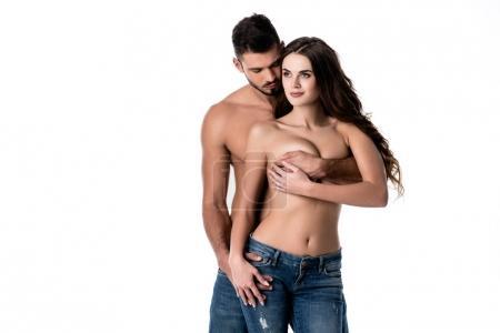 Photo pour Jeune couple sensuel en jeans isolé sur blanc - image libre de droit