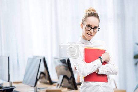 young caucasian student girl in empty classroom