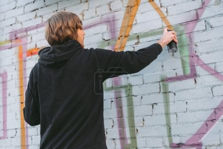 Photo for Street artist painting colorful graffiti on wall of building - Royalty Free Image