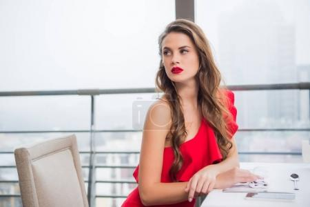 side view of pensive woman waiting for boyfriend on date in restaurant