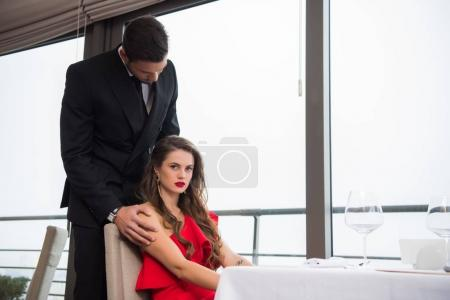 young couple in love on romantic date on st valentine day in restaurant