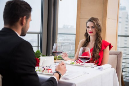 partial view of couple in love having romantic date in restaurant on st valentine day