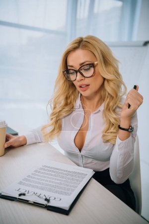 sexy businesswoman reading working contract