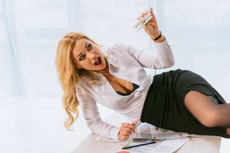 attractive sexy woman screaming and posing with stapler