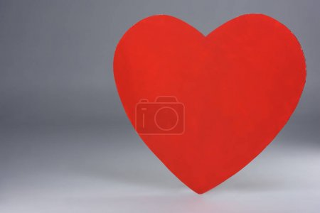 simple red heart sign on grey