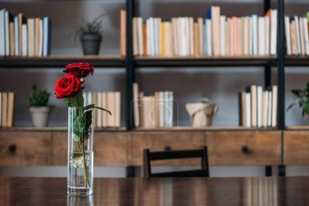 beautiful red roses in vase at library