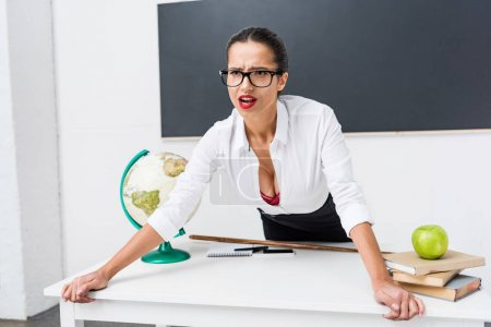 Photo for Young angry teacher shouting at classroom - Royalty Free Image