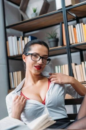 young seductive teacher taking off shirt at library