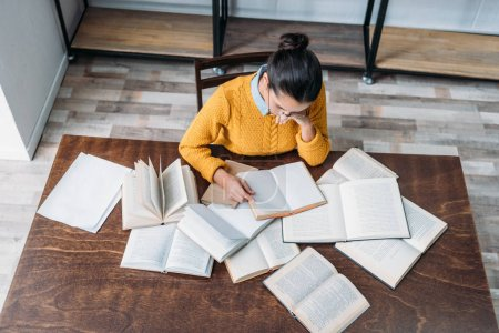 high angle view of young student girl preparing for exam at library