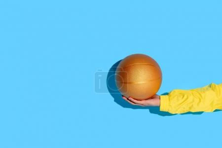 Cropped image of man hand with basketball ball in hand