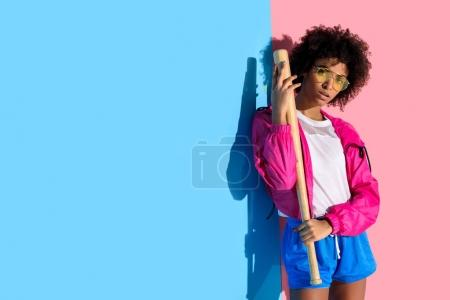 Young bright african american girl with baseball bat