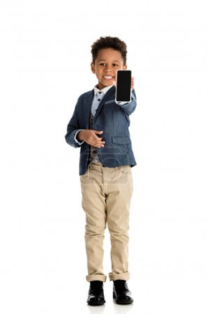 Photo for Smiling african american kid showing smartphone isolated on white - Royalty Free Image