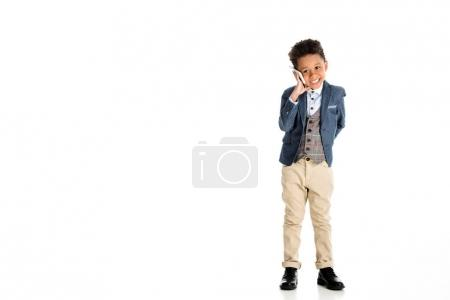 Photo for Smiling african american kid talking by smartphone on white - Royalty Free Image