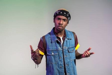 Photo for Aggressive young african american man gesturing with hands and looking at camera isolated on grey - Royalty Free Image
