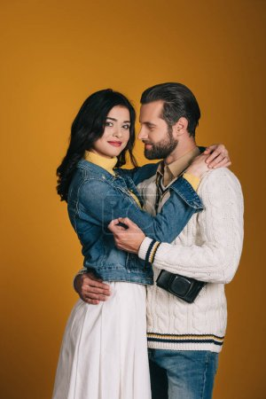 boyfriend and girlfriend hugging isolated on yellow