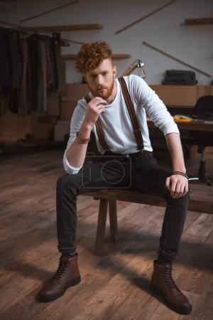 Photo for Full length view of handsome stylish young male fashion designer sitting and looking at camera - Royalty Free Image