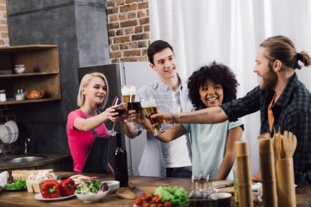 multiethnic friends clinking with glasses of wine and beer