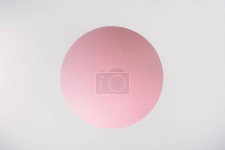 Photo pour Trou rond rose avec espace de copie sur gris - image libre de droit