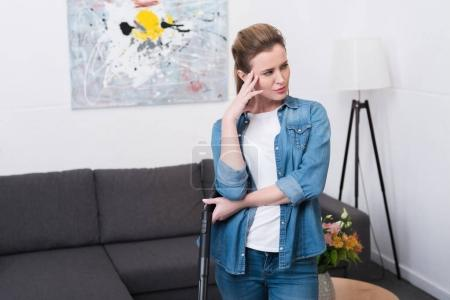 Photo for Portrait of tired woman with vacuum cleaner looking away at home - Royalty Free Image