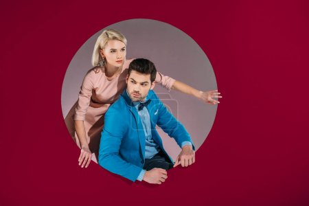 Photo for Beautiful couple in stylish clothes on burgundy - Royalty Free Image