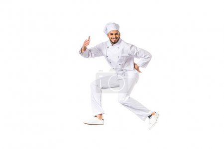 Photo for Happy male chef showing thumb up and smiling at camera isolated on white - Royalty Free Image